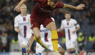 Roma forward Edin Dzeko controls the ball the ball during a Champions League, Group G soccer match between AS Roma and CSKA Moscow, at the Olympic stadium in Rome, Tuesday, Oct. 23, 2018. (AP Photo/Gregorio Borgia)