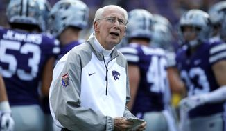 FILE - In this Sept. 1, 2018, file photo, Kansas State head coach Bill Snyder watches his team warm up before an NCAA college football game against the South Dakota, in Manhattan, Kan. No matter how good or bad Kansas State has performed in the weeks leading into its bye, coach Snyder seems to always have the Wildcats ready to return when the opponent is Oklahoma. The last two such times the Wildcats have been victorious. (AP Photo/Charlie Riedel, File)