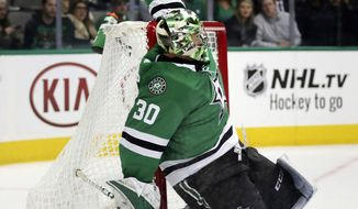 Dallas Stars goaltender Ben Bishop makes a save against the Los Angeles Kings in the second period of an NHL hockey game in Dallas, Tuesday, Oct. 23, 2018. (AP Photo/Andy Jacobsohn)