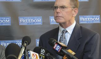 FILE--In this Feb. 2, 2018, file photo, Douglas Haig takes questions from reporters at a news conference in Chandler, Ariz. The trial has been pushed back to next year for the 55-year-old Arizona man facing a federal ammunition-manufacturing charge in Las Vegas in connection with the deadliest mass shooting in the nation's modern history. (AP Photo/Brian Skoloff, file)