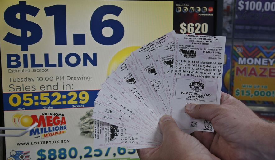 A customer, who did not want to be identified, displays the $200 worth of Mega Millions tickets he bought at Downtown Plaza convenience store in Oklahoma City, Tuesday, Oct. 23, 2018. (AP Photo/Sue Ogrocki)