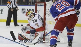 Florida Panthers goaltender Michael Hutchinson (39) stops a shot on the goal by New York Rangers' Chris Kreider (20) during the second period an NHL hockey game Tuesday, Oct. 23, 2018, in New York. (AP Photo/Frank Franklin II)