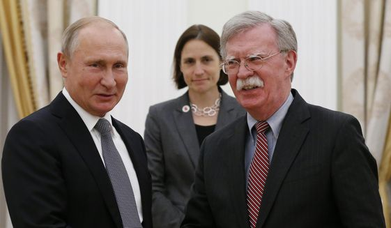 Russian President Vladimir Putin, left, and U.S. National Security Adviser John Bolton shakes hands during their meeting in the Kremlin in Moscow, Russia, on Tuesday, Oct. 23, 2018. (AP Photo/Alexander Zemlianichenko)