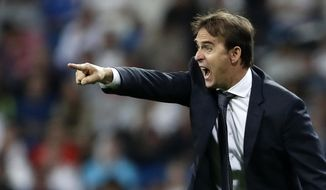 Real coach Julen Lopetegui gives instructions to his players during a Group G Champions League soccer match between Real Madrid and Viktoria Plzen at the Santiago Bernabeu stadium in Madrid, Spain, Tuesday Oct. 23, 2018. (AP Photo/Manu Fernandez)