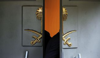 Officials enter Saudi Arabia's consulate in Istanbul, Tuesday, Oct. 23, 2018. Saudi officials murdered Saudi writer Jamal Khashoggi in their Istanbul consulate after plotting his death for days, Turkey's President Recep Tayyip Erdogan said Tuesday, contradicting Saudi Arabia's explanation that the writer was accidentally killed. (AP Photo/Lefteris Pitarakis)