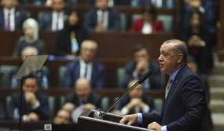 Turkey's President Recep Tayyip Erdogan addresses members of his ruling Justice and Development Party (AKP), in Ankara, Turkey, Tuesday, Oct. 23, 2018. Turkey's president says Saudi officials started planning to murder Saudi writer Jamal Khashoggi days before his death in Saudi Arabia's Istanbul consulate. (AP Photo/Ali Unal)