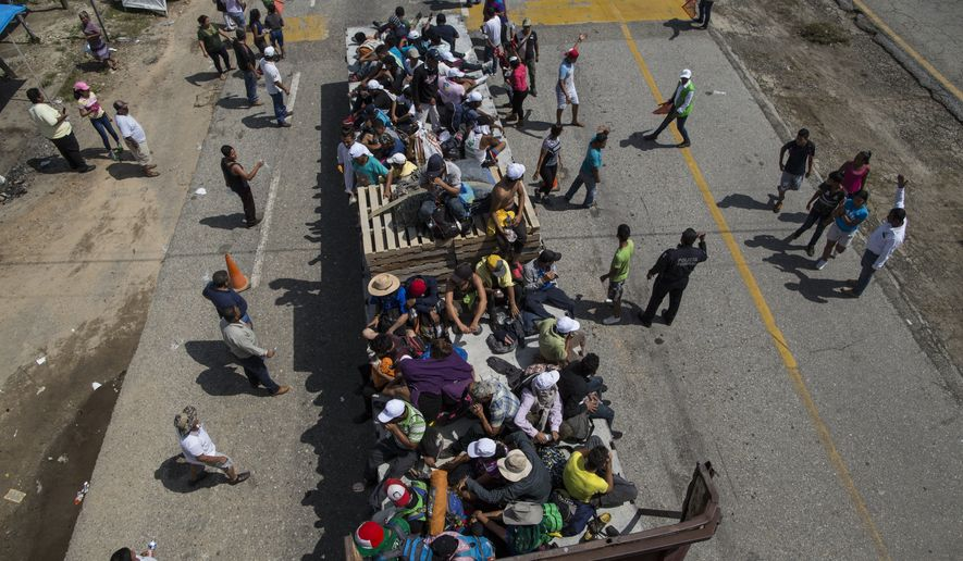 Central American migrants traveling with a caravan to the U.S. get a free ride on a tuck bed from a driver, as they approach Mapastepec, Mexico, Wednesday, Oct. 24, 2018. Thousands of Central American migrants renewed their hoped-for march to the United States on Wednesday, setting out before dawn with more than 1,000 miles still before them. (AP Photo/Rodrigo Abd)