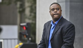 Former amateur basketball league director Merl Code pushes a stroller as he leaves federal court in New York, Wednesday, Oct. 24, 2018. Code and two other insiders from the high-stakes world of college basketball recruiting were convicted Wednesday in a corruption case that prosecutors said exposed the underbelly of the sport. (AP Photo/Bebeto Matthews)
