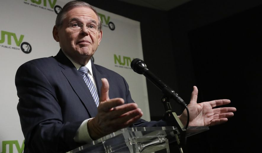 New Jersey Sen. Bob Menendez, the Democratic candidate for the U.S. Senate in New Jersey, speaks to reporters after a debate with Republican candidate Bob Hugin, Wednesday, Oct. 24, 2018, in Newark, N.J. (AP Photo/Julio Cortez) ** FILE **