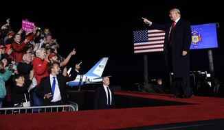 President Donald Trump arrives to speak at a rally at Central Wisconsin Airport in Mosinee, Wis., Wednesday, Oct. 24, 2018. (AP Photo/Susan Walsh)