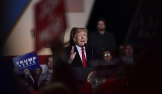 President Donald Trump speaks during a rally at Central Wisconsin Airport in Mosinee, Wis., Wednesday, Oct. 24, 2018. (AP Photo/Susan Walsh)