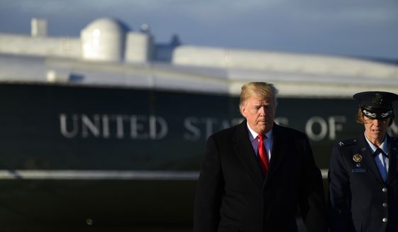 President Donald Trump walks to board Air Force One at Andrews Air Force Base in Md., Wednesday, Oct. 24, 2018. Trump is heading to Wisconsin for a rally. (AP Photo/Susan Walsh)