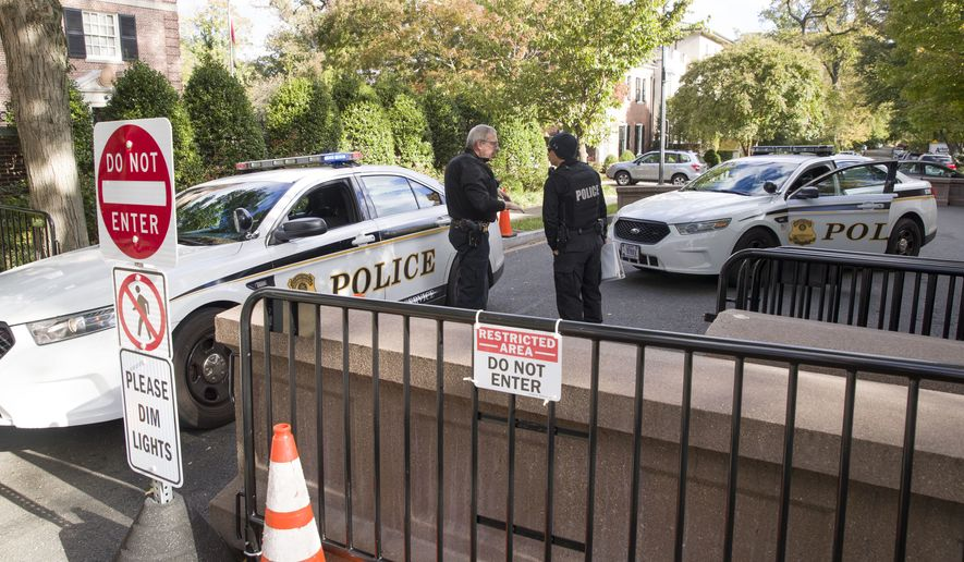 "Officers with the Uniform Division of the United States Secret Service talk at a checkpoint near the home of President Barack Obama, Wednesday, Oct. 24, 2018, in Washington. The U.S. Secret Service says agents have intercepted packages containing ""possible explosive devices"" addressed to former President Barack Obama and Hillary Clinton. (AP Photo/Alex Brandon)"