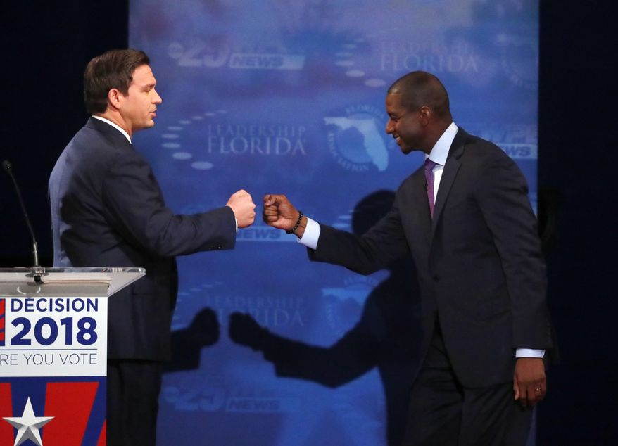 Florida gubernatorial candidates, Republican Ron DeSantis, left, and Democrat Andrew Gillum fist bump after a debate, Wednesday, Oct. 24, 2018, at Broward College in Davie, Fla. (AP Photo/Wilfredo Lee, Pool)