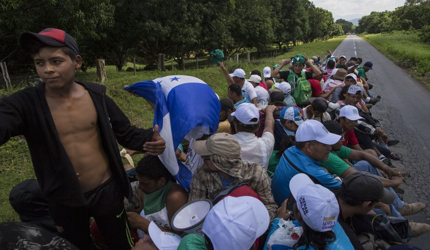 Central American migrants traveling with a caravan to the U.S,  hitch a ride from a truck driver to Mapastepec, Mexico, Wednesday, Oct. 24, 2018,. Thousands of Central American migrants renewed their hoped-for march to the United States on Wednesday, setting out before dawn with plans to travel another 45 miles (75 kilometers) of the more than 1,000 miles that still lie before them. (AP Photo/Rodrigo Abd)