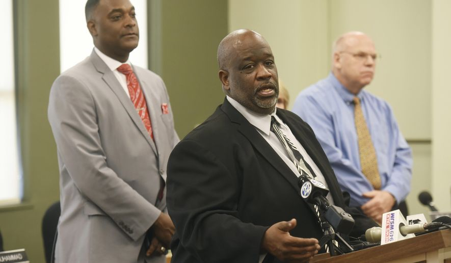 From left, Benton Harbor Mayor Marcus Muhammad, Benton Harbor City Manager Darwin Watson and Berrien County Medical Director Dr. Rick Johansen hold a press conference Wednesday, Oct. 24, 2018, at City Hall in Benton Harbor, Mich., to let the public know thatthe city's water system is under a state advisory for lead after summer sampling revealed higher-than-acceptable levels. City Manager Watson saysthe citywill test residents' water for free. The advisory came after water samples from eight ofthe 30 homes tested were above the action level of 15 parts per billion (ppb) for lead andthe 90th percentile ofthe samples was 22ppb for lead.  (Don Campbell/The Herald-Palladium via AP)