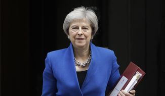 British Prime Minister Theresa May leaves 10 Downing Street in London, to attend Prime Minister's Questions at the Houses of Parliament, Wednesday, Oct. 24, 2018. (AP Photo/Matt Dunham)