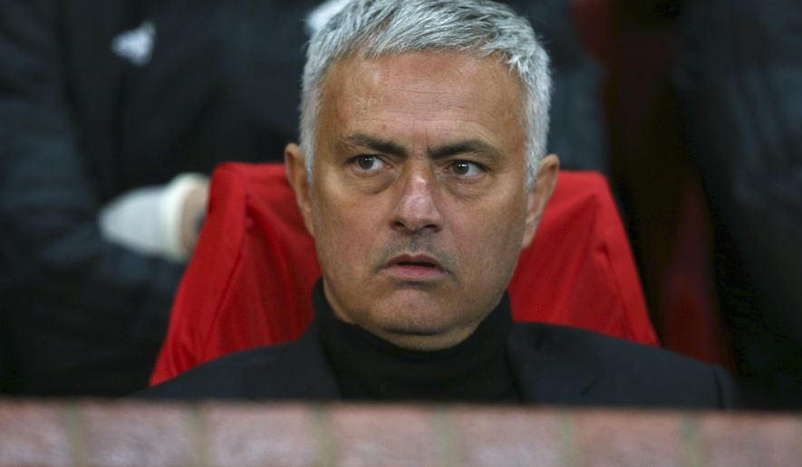 ManU coach Jose Mourinho sits on the bench during the Champions League group H soccer match between Manchester United and Juventus at Old Trafford, Manchester, England, Tuesday, Oct. 23, 2018. (AP Photo/Dave Thompson)