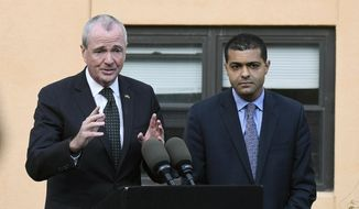 New Jersey Gov. Phil Murphy speaks about the adenovirus outbreak as New Jersey Department of Health Commissioner Dr. Shereef Elnahal looks during a press conference at the The Wanaque Center for Nursing and Rehabilitation on Wednesday, Oct. 24, 2018 in Wanaque, N.J. (Michael Karas/The Record via AP) ** FILE **