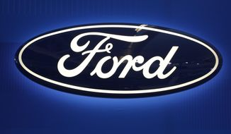 FILE - This Feb. 11, 2016, file photo shows the Ford logo on display at the Pittsburgh International Auto Show in Pittsburgh. Ford Motor Co. revamped its Asian operations and made its China business a stand-alone unit, recruiting the head of local automaker Chery Automobile to be its new CEO. The company said Wednesday, Oct. 24, 2018, that industry veteran Chen Anning will replace Jason Luo, who quit earlier this year, just months after taking over at Ford in China. (AP Photo/Gene J. Puskar, File)