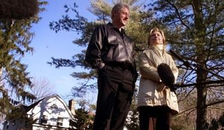 "FILE - In this Jan. 6, 2000 file photo, Bill and Hillary Clinton stand in the driveway of their new home in Chappaqua, N.Y. A U.S. official says a ""functional explosive device"" was found at Hillary and Bill Clinton's suburban New York home. (AP Photo, File) **FILE**"