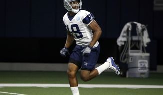 Dallas Cowboys receiver Amari Cooper (19) runs a pass route during NFL football practice in Frisco, Texas, Wednesday, Oct. 24, 2018. (AP Photo/Michael Ainsworth)