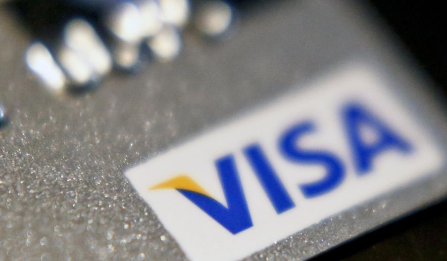 FILE- This June 13, 2018, file photo shows a Visa logo on a credit card in Zelienople, Pa. Visa Inc. reports earnings Wednesday, Oct. 24. (AP Photo/Keith Srakocic, File)