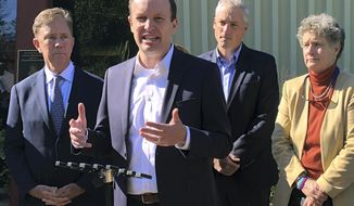 In this Oct. 18, 2018 photo, U.S. Sen. Chris Murphy, front, speaks during a campaign appearance at a senior center in West Hartford, Conn.. Joining him are Democratic gubernatorial candidate Ned Lamont, left, state Rep. Derek Slap, second from right, and state Sen. Beth Bye, right. Murphy is playing an outsized role in Connecticut's elections this year, in addition to second re-election to a second term in the U.S. Senate. (AP Photo/Susan Haigh)