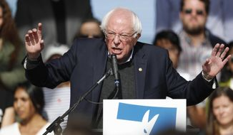 U.S. Senator Bernie Sanders speaks during a rally with young voters on the campus of the University of Colorado Wednesday, Oct. 24, 2018, in Boulder, Colo. Sanders is riding a bus around the state with Democratic candidates to drum up support for them before Election Day. (AP Photo/David Zalubowski)
