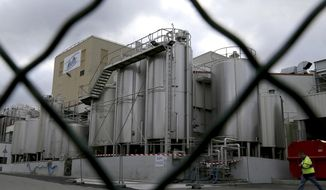 FILE - This Dec. 11, 2017 file picture shows a general view of the Lactalis plant and milk production site in Craon, western France. Dairy giant Lactalis has firmly denied claims made by a French investigative newspaper that it sold 8,000 tons of milk powder contaminated with salmonella. (AP Photo/David Vincent, File)