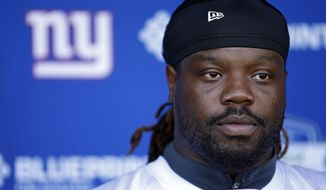 """In this June 12, 2018, file photo, New York Giants defensive tackle Damon Harrison talks to reporters in East Rutherford, N.J. A person with knowledge of the deal tells The Associated Press the New York Giants are trading star defensive tackle Damon """"Snacks"""" Harrison to the Detroit Lions. The person says the Giants will receive a fifth-round pick in 2019 for the stalwart in the middle of the defensive line. The person spoke to the AP on condition of anonymity Wednesday, Oct. 24, 2018, because the deal has not been announced. (AP Photo/Adam Hunger) **FILE**"""