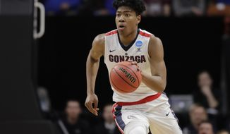 FILE - In this Thursday, March 15, 2018 file photo, Gonzaga forward Rui Hachimura moves the ball against UNC-Greensboro during an NCAA men's college basketball tournament first-round game in Boise, Idaho. This is the 20th anniversary of No. 3 Gonzaga's 1999 run to the Elite Eight that vaulted the Bulldogs to national prominence, and coach Mark Few might have his best team ever. With a bounty of new and returning stars, including NBA hopefuls Rui Hachimura and Killian Tillie, the Zags seem poised to make a run again at their first national title. (AP Photo/Ted S. Warren File)