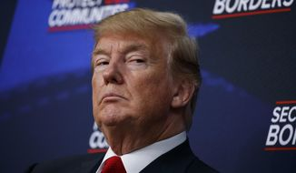 In this June 22, 2018, file photo, President Donald Trump listens during an event on immigration alongside family members affected by crime committed by undocumented immigrants, at the South Court Auditorium on the White House complex in Washington. (AP Photo/Evan Vucci)