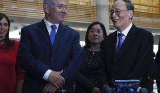 China's Vice President Wang Qishan, right, and Israeli Prime Minister Benjamin Netanyahu tour the Israeli Innovation Summit in Jerusalem, Wednesday, Oct. 24, 2018. (AP Photo/Ariel Schalit, Pool)