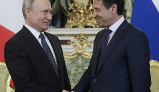 Russian President Vladimir Putin, left, shakes hands with Italian Prime Minister Giuseppe Conte during their meeting in the Kremlin in Moscow, Russia, Wednesday, Oct. 24, 2018. Italian Prime Minister Giuseppe Conte is holding talks with Russian officials on his first trip to Moscow. (Sergei Chirikov/Pool Photo via AP)