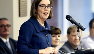 FILE - In this Feb. 2, 2018 file photo, Oregon Gov. Kate Brown speaks in Portland, Ore. The Oregon Department of Education, whose leader was chosen by Gov. Kate Brown, has decided to delay releasing its annual school performance ratings until after the high-stakes Nov. 6 election. The Oregonian/OregonLive reports the statistical rankings have been in school districts' hands since Oct. 4 in preparation for the originally scheduled Oct. 25 release of the ratings to the public. (AP Photo/Don Ryan, File)