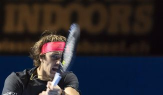 Germany's Alexander Zverev returns a ball to Holland's Robin Haase during their first round match at the Swiss Indoors tennis tournament at the St. Jakobshalle in Basel, Switzerland, on Wednesday, Oct. 24, 2018. (Georgios Kefalas/Keystone via AP)