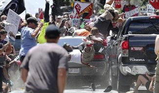 In this Aug. 12, 2017, file photo, people fly into the air as a vehicle drives into a group of protesters demonstrating against a white nationalist rally in Charlottesville, Va. (Ryan M. Kelly/The Daily Progress via AP, File)/The Daily Progress via AP)