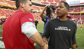 FILE - In this Oct. 7, 2018, file photo, San Francisco 49ers head coach Kyle Shanahan, left, shakes hands with Arizona Cardinals head coach Steve Wilks after an NFL football game, in Santa Clara, Calif. One thing for certain about Sunday's game between the San Francisco 49ers and Arizona Cardinals. No team in the NFL will have a worse record than the team that loses this game.  (AP Photo/Ben Margot, File)