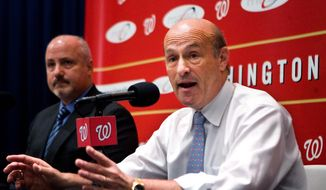 Washington Nationals' President Stan Kasten, right, and Vice President of Baseball Operations Mike Rizzo, speak during a news conference discussing the teams managerial situation, Monday, July 13, 2009, in Washington. Washington Nationals relieved Manny Acta as manager and named Jim Riggleman interim field manager. (AP Photo/Manuel Balce Ceneta) **FILE**
