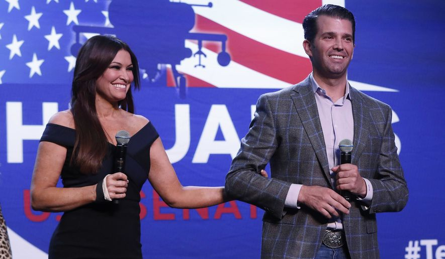 Donald Trump Jr., and Kimberly Guilfoyle appear at a rally for Republican U.S. Senate candidate John James in Pontiac, Mich., Wednesday, Oct. 17, 2018. (AP Photo/Paul Sancya)