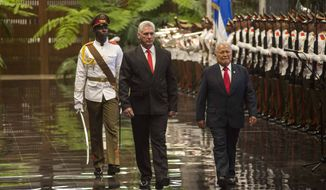 El Salvador President Salvador Sanchez Ceren, right, and Cuba's President Miguel Diaz-Canel review an honor guard at the Revolution Palace in Havana, Cuba, Thursday, Oct. 25, 2018. Ceren is on an official visit to Cuba. (AP Photo/Desmond Boylan)