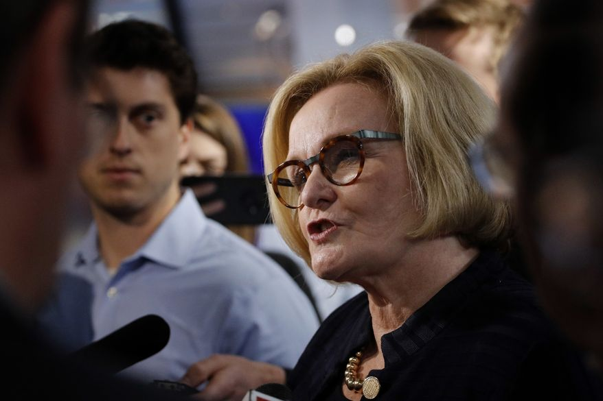 Missouri incumbent Democratic Sen. Claire McCaskill talks to the media after a debate against Republican challenger Josh Hawley  Thursday, Oct. 25, 2018, in Kansas City, Mo. (AP Photo/Charlie Riedel)