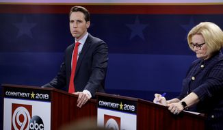 Missouri U.S. Senate candidates incumbent Democratic Sen. Claire McCaskill, right, and Republican challenger Josh Hawley wait for the start of a debate Thursday, Oct. 25, 2018, in Kansas City, Mo. (AP Photo/Charlie Riedel)