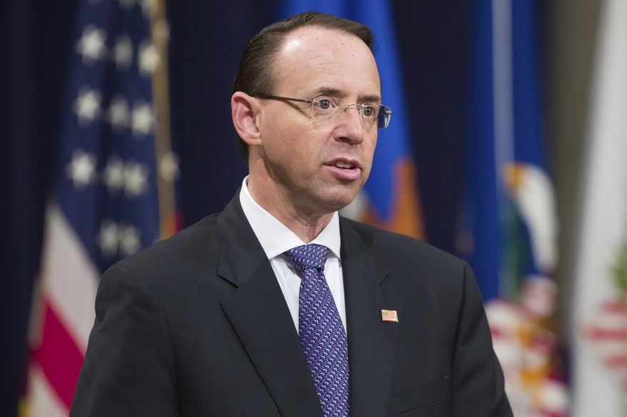 Deputy Attorney General Rod Rosenstein speaks during an event to announce new strategic actions to combat the opioid crisis at the Department of Justice's National Opioid Summit in the Great Hall at the Department of Justice, Thursday, Oct. 25, 2018, in Washington. (AP Photo/Alex Brandon) ** FILE **