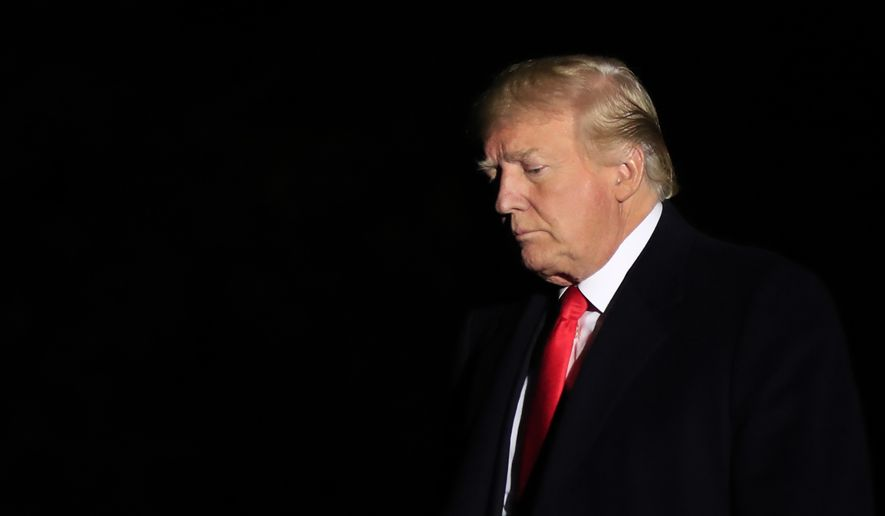 In this Oct. 24, 2018, file photo President Donald Trump arrives the White House in Washington from a campaign rally in Mosinee, Wis. (AP Photo/Manuel Balce Ceneta) **FILE**