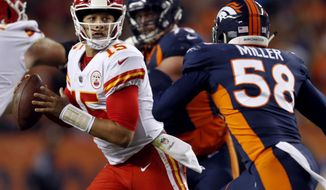 FILE - in this Oct. 1, 2018, file photo, Kansas City Chiefs quarterback Patrick Mahomes (15) scrambles as Denver Broncos linebacker Von Miller (58) pursues during the first half of an NFL football game in Denver. The two teams play each other again Sunday, Oct. 28. (AP Photo/David Zalubowski, File)