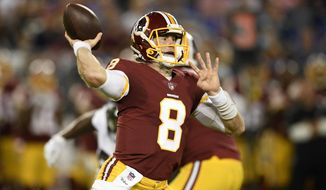 FILE - In this Aug. 30, 2018, file photo, then-Washington Redskins quarterback Kevin Hogan throws in the first half of a preseason NFL football game against the Baltimore Ravens, in Baltimore. If anything happens the Case Keenum, the Denver Broncos' offense would be in the hands of Kevin Hogan. The Broncos were awarded Hogan off waivers from Washington last month after Chad Kelly had beaten out Paxton Lynch for the No. 2 job in Denver. Kelly was dismissed from the team Wednesday, Oct. 24, a day after his arrest on suspicion on criminal trespass in the hours after a team-building Western-themed Halloween party held at the Gothic Theatre in Englewood. (AP Photo/Nick Wass)