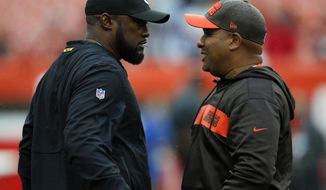 FILE - In this Sept. 9, 2018, file photo, Pittsburgh Steelers head coach Mike Tomlin, left, and Cleveland Browns head coach Hue Jackson talk before an NFL football game in Cleveland. Each fall the Browns make their way to Heinz Field, typically with a new quarterback and frequently with a new head coach in tow. And each trip ends in similar fashion: with a quiet bus ride back home after another stinging defeat in a rivalry that hasn't felt like much of one for more than two decades. (AP Photo/Ron Schwane, File)