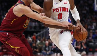 Cleveland Cavaliers forward Larry Nance Jr. (22) knocks the ball away from Detroit Pistons center Andre Drummond (0) during the first half of an NBA basketball game, Thursday, Oct. 25, 2018, in Detroit. (AP Photo/Carlos Osorio)